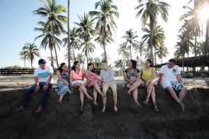group of happy people sitting on a beach 300x200 - group-of-happy-people-sitting-on-a-beach