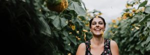 happy woman standing in a field of sunflowers 300x110 - happy-woman-standing-in-a-field-of-sunflowers